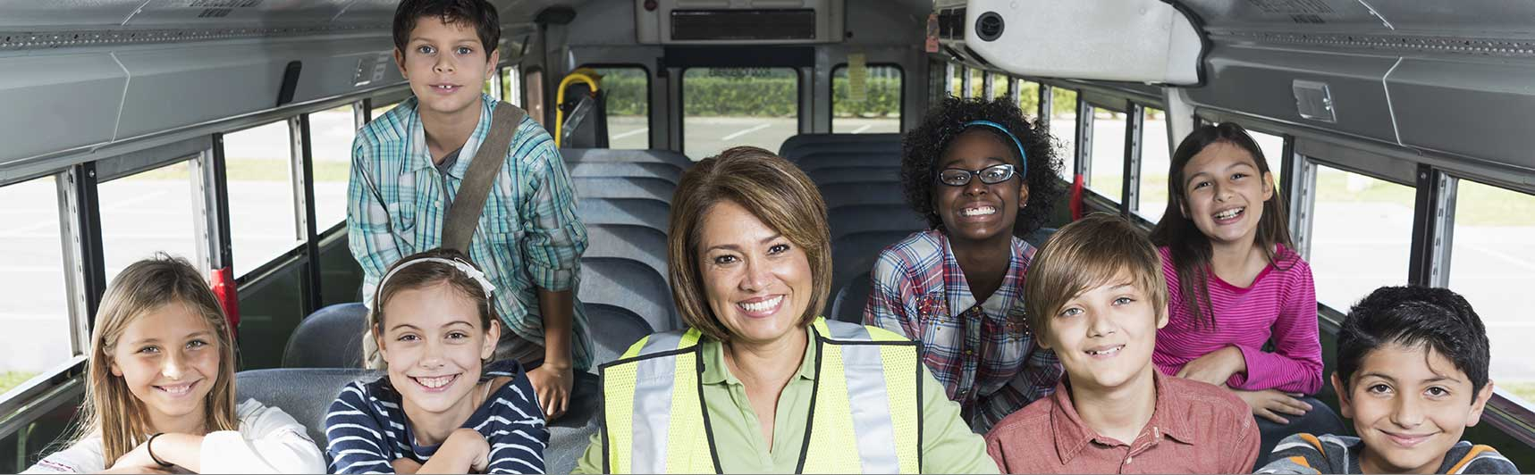 Image of kids and bus lady in the bus