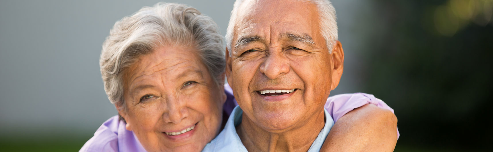 Elderly couples smiling